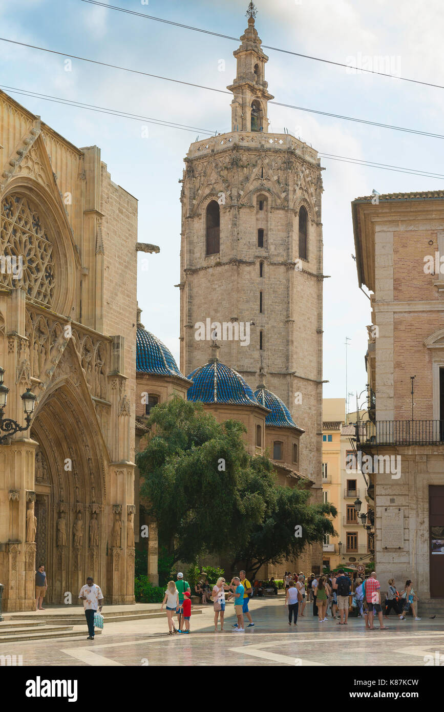 Valencia Spain, tourists stand in the Plaza de la Virgen near the Cathedral entrance and the landmark Miguelete Stock Photo