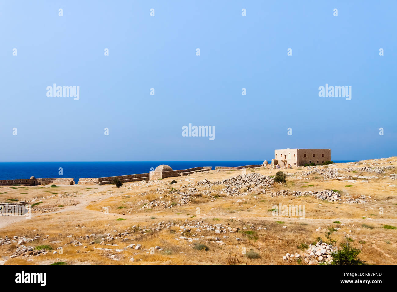 Panoramic view of the walls of the Venetian Fortress (Fortezza) with the sea in the background. Rethymno, Crete, Stock Photo