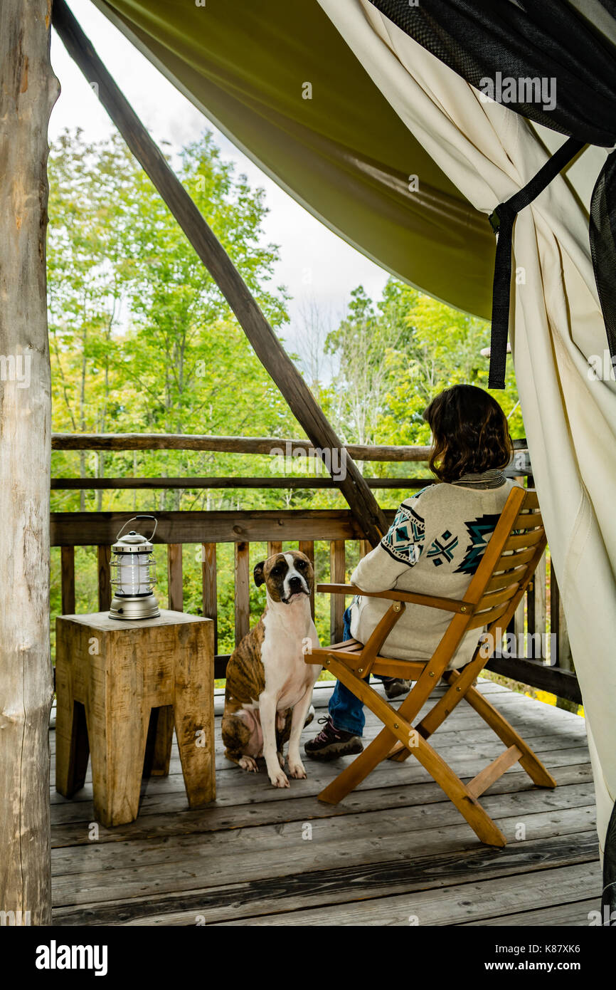 A woman and her dog glamping in New York. - Stock Image