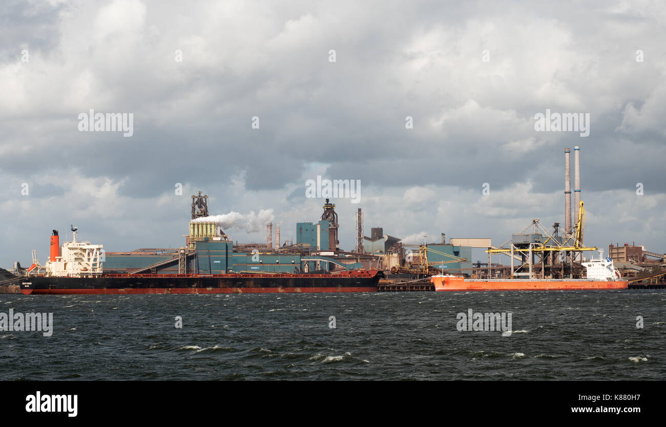Bulk carriers South Trader and Cepheus Ocean moored at Ijmuiden steelworks, Holland, Europe - Stock Image