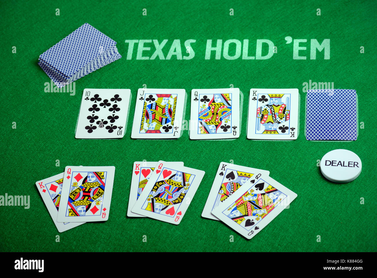 Poker cards on green poker cloth. Texas Hold'em - Stock Image