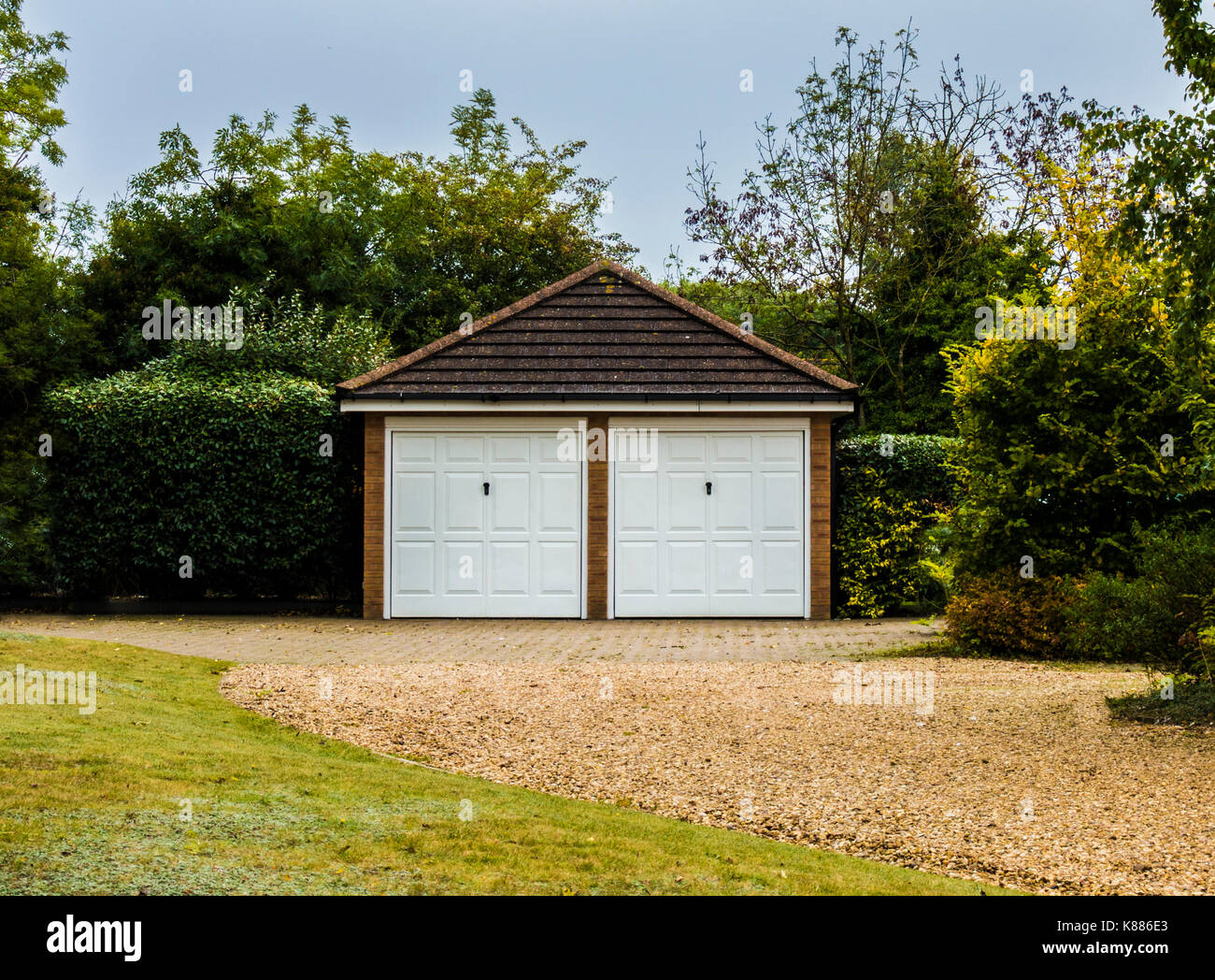 Modern Spacious Detached Double Garage With Matching White Doors Stock Photo Alamy