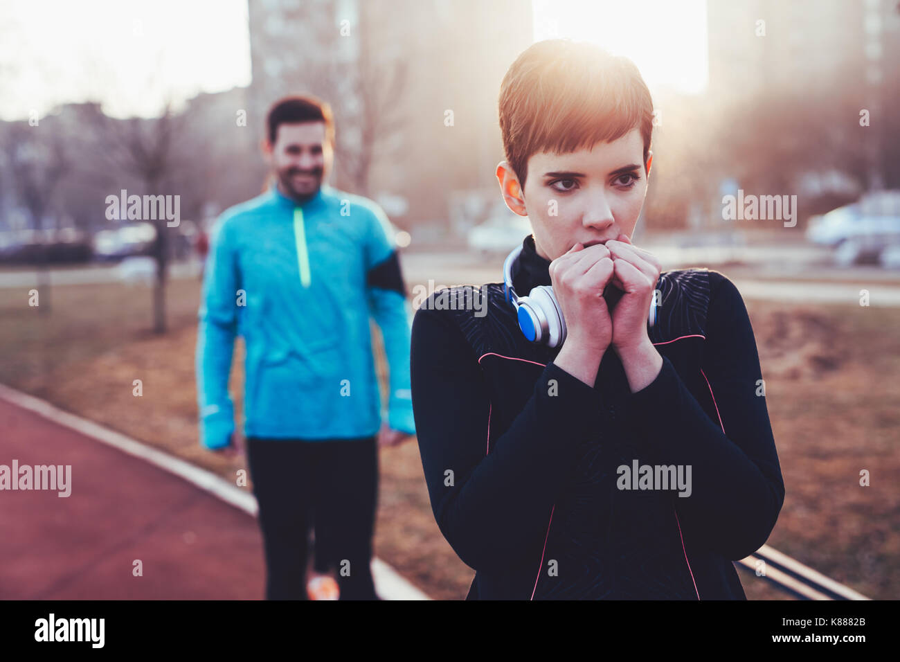 Woman fitness exercising in cold weather outdoor - Stock Image