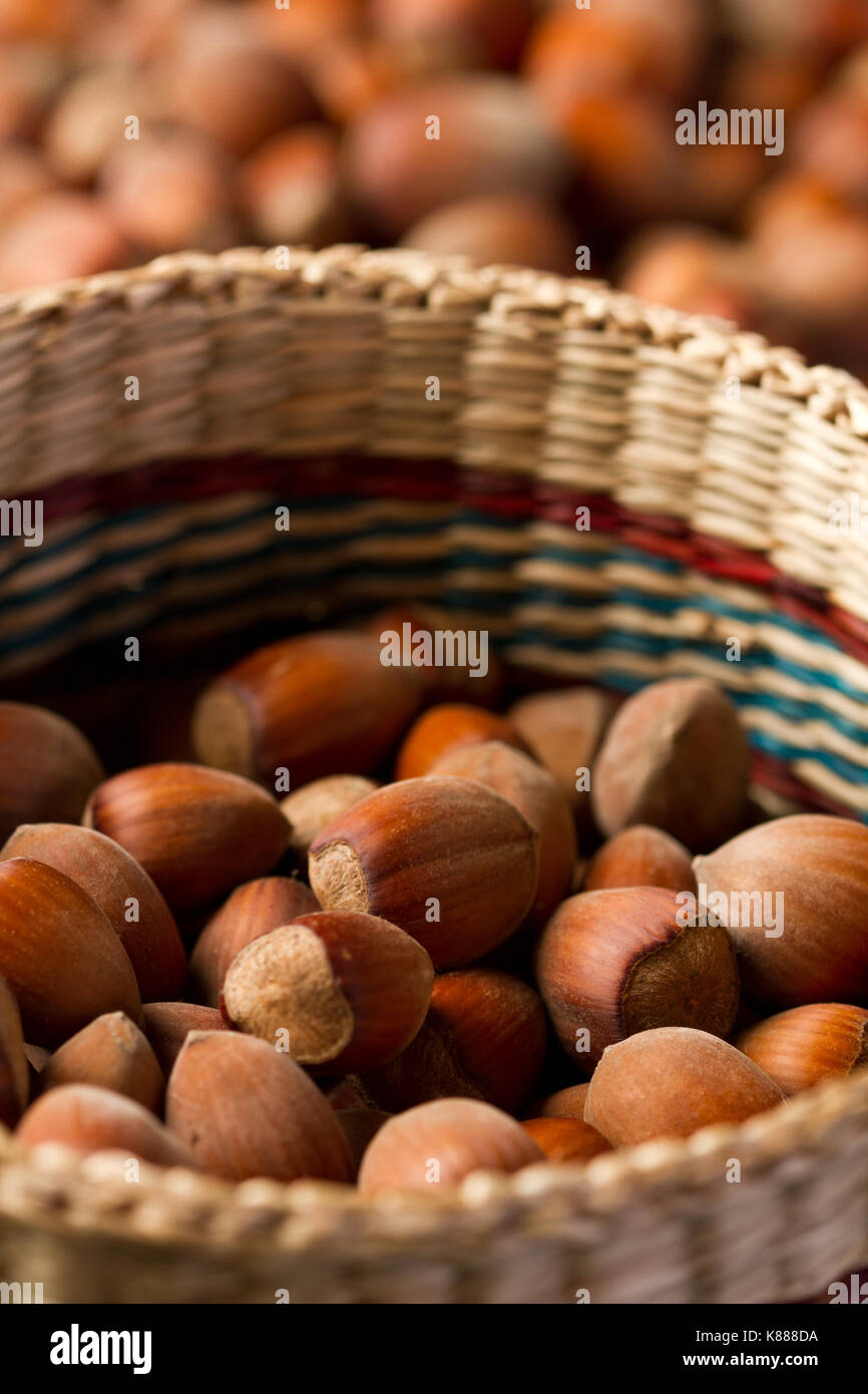 Hazelnuts on old wooden table - Stock Image