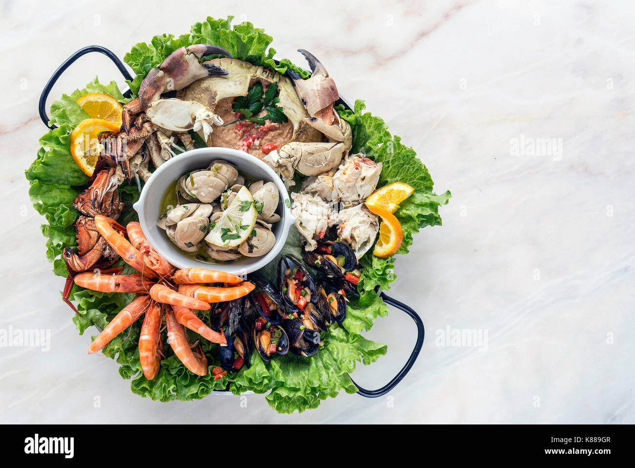 mixed fresh portuguese seafood selection gourmet set platter meal on table - Stock Image