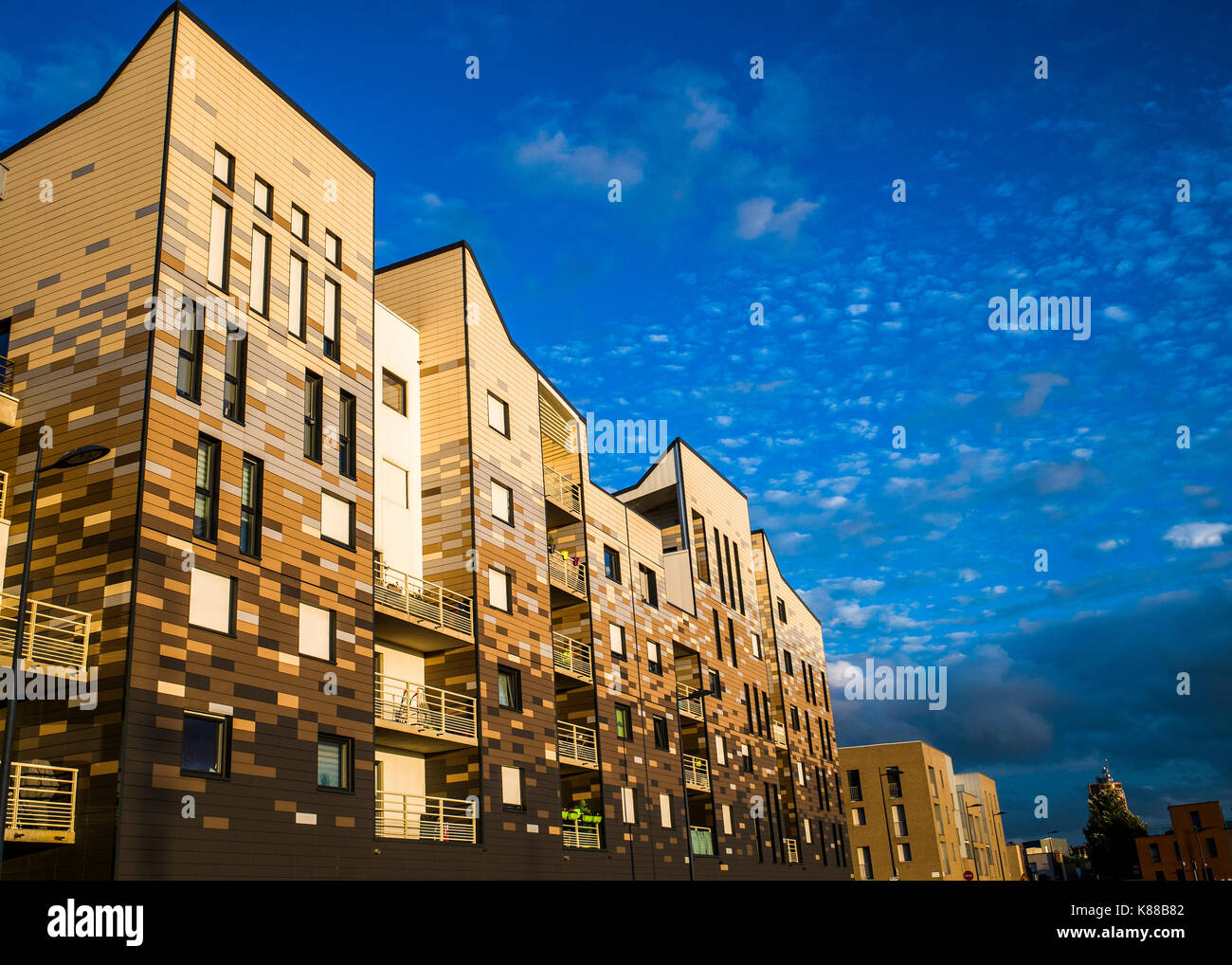 modern block of flats in dunkirk harbour at sunset - Stock Image