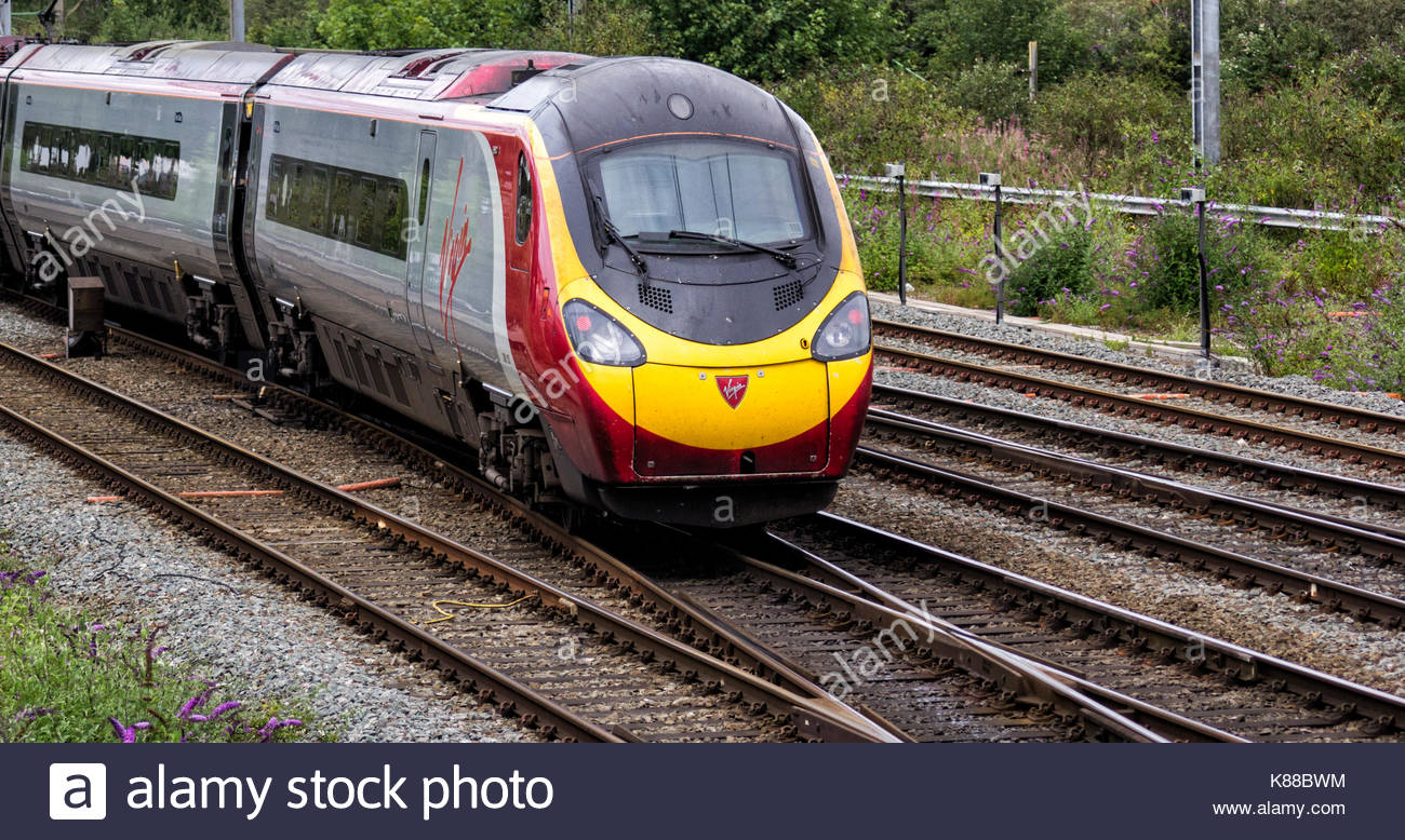 Virgin Trains Pendolino Class 390, approaching Crewe Station - Stock Image
