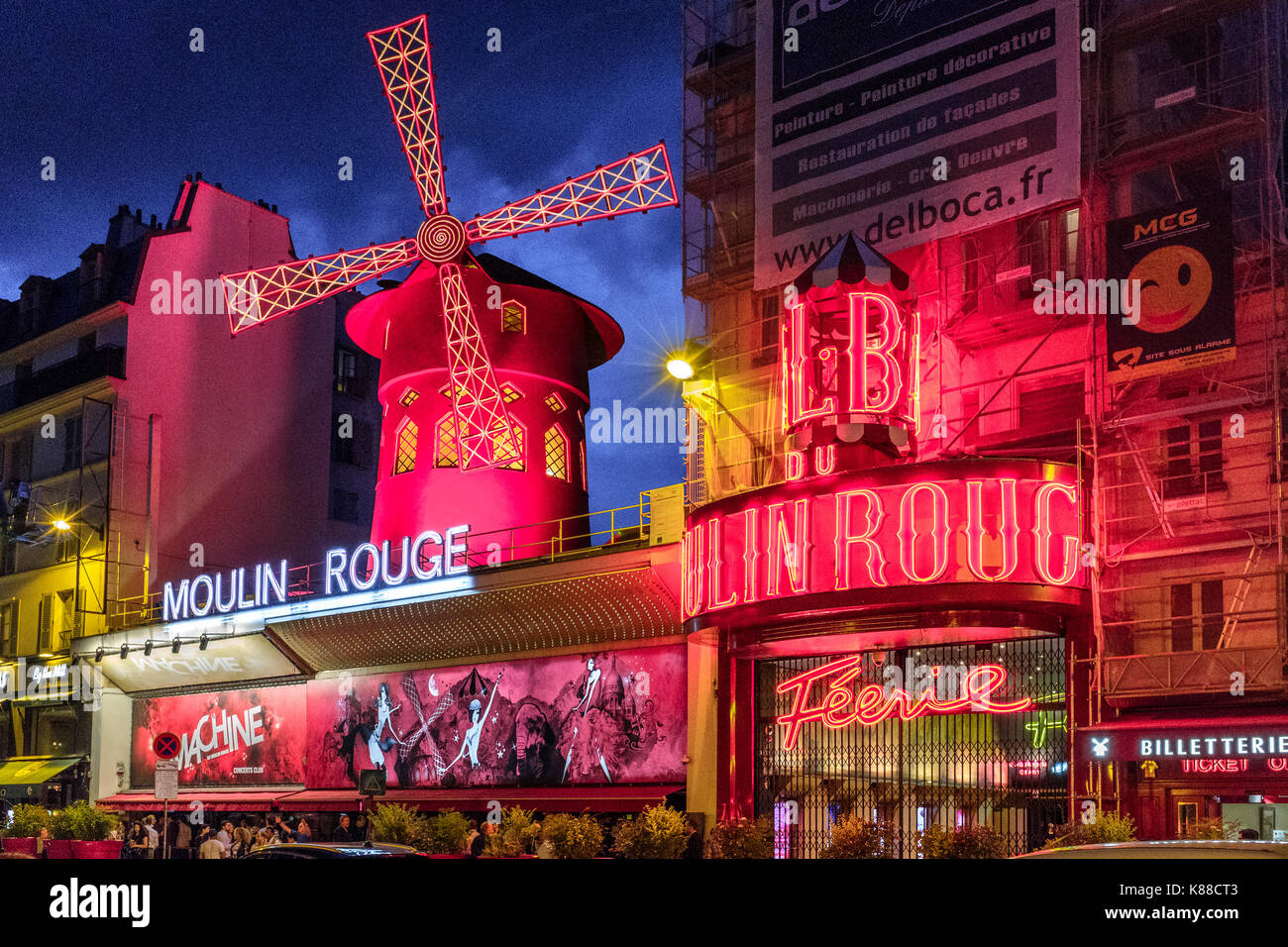 Moulin Rouge at night,Paris France - Stock Image