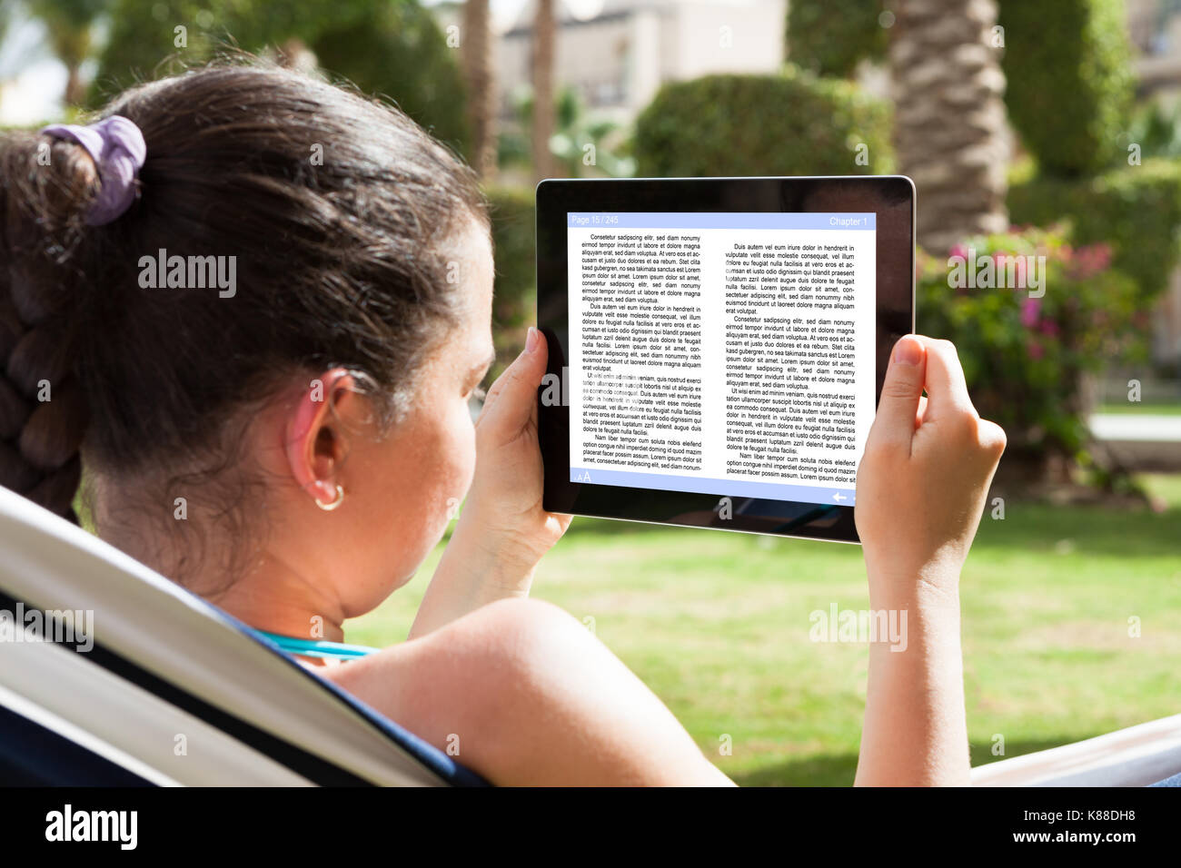 Closeup Of A Young Woman Reading Ebook - Stock Image