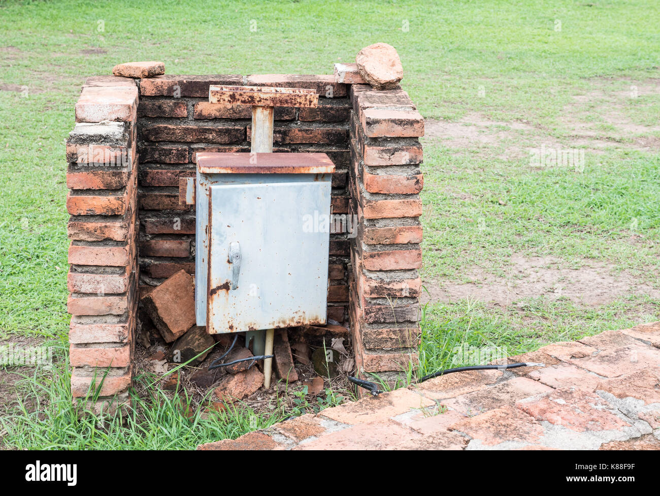 Rustry control box for electrical distribution in the historical park. Stock Photo