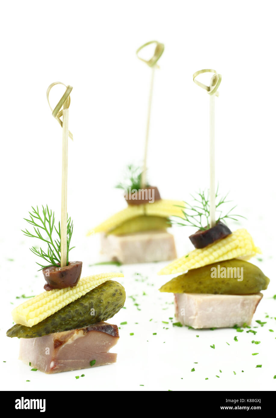 Finger food with meat and vegetables - Stock Image