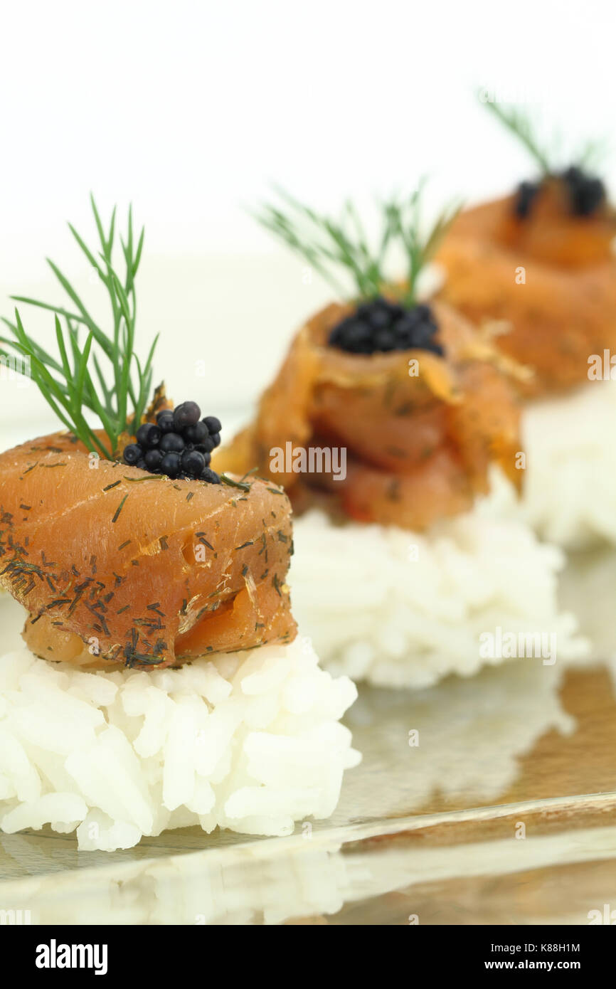 Rice with salmon and caviar - Stock Image