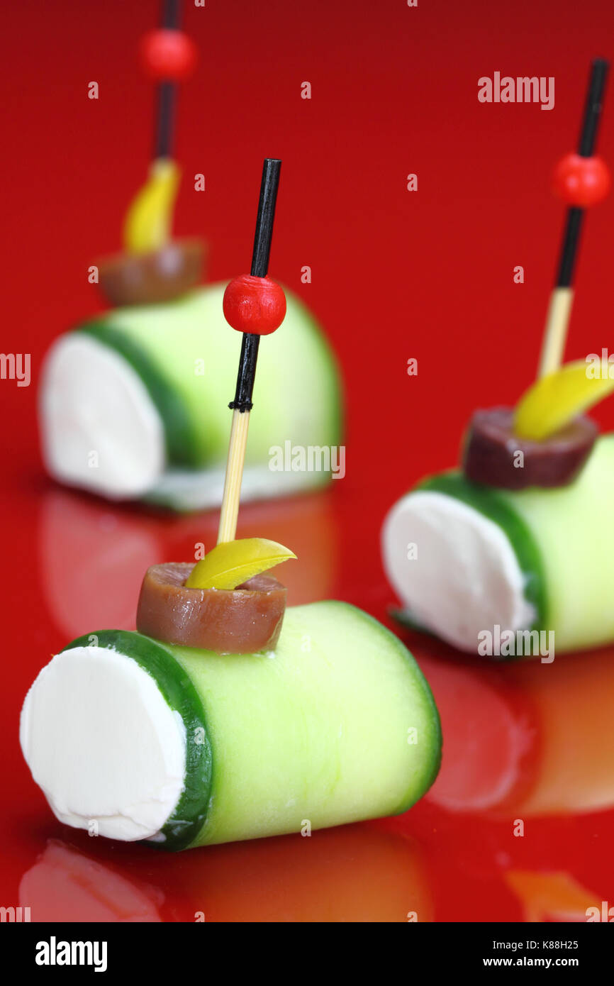 Finger food with Cucumber and cheese cream - Stock Image