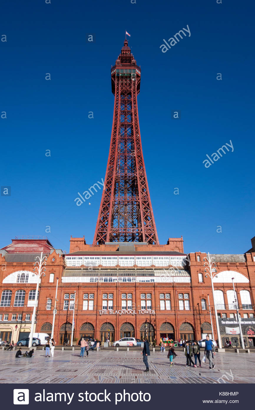 The prominent and famous Blackpool Tower stands over the promenade at the famous seaside resort on the Fylde Coast, Stock Photo