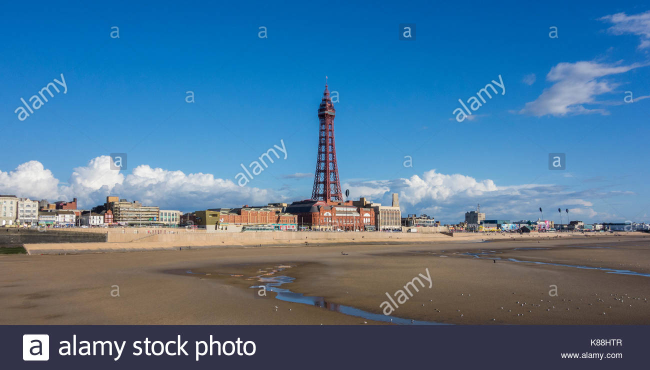 The prominent and famous Blackpool Tower stands over the promenade at the famous seaside resort on the Fylde Coast, - Stock Image