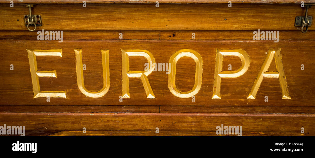 Rich gold lettering on gold on the ship Europa - Stock Image