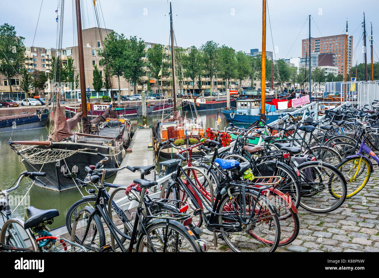 Netherlands, South Holland, Rotterdam, Maritime District, bicycle parking at Haringvliet, part of Rotterdams old - Stock Image
