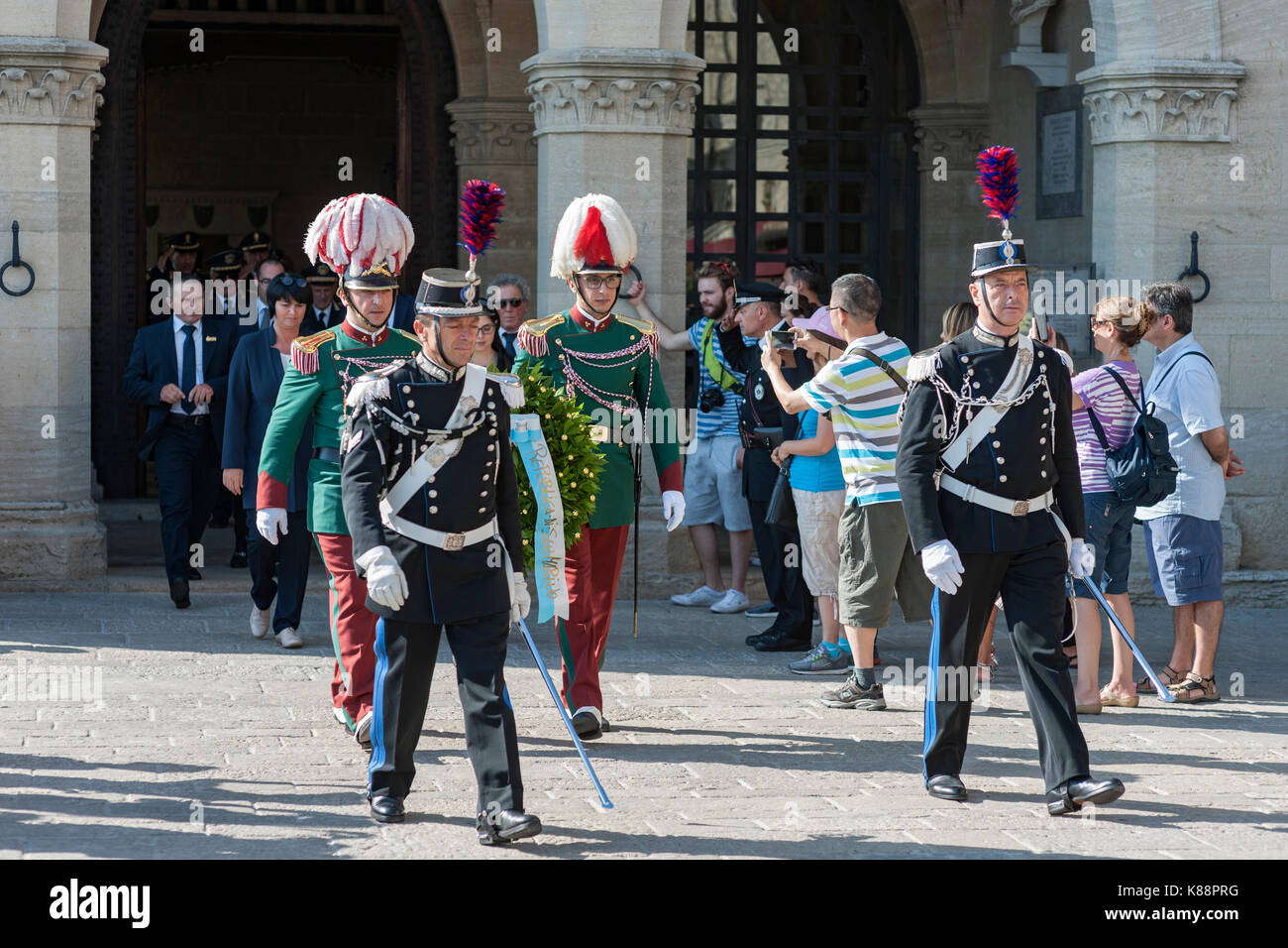 Government officials and uniformed guards outside the Palazzo Pubblico (Public Palace) in San Marino. - Stock Image