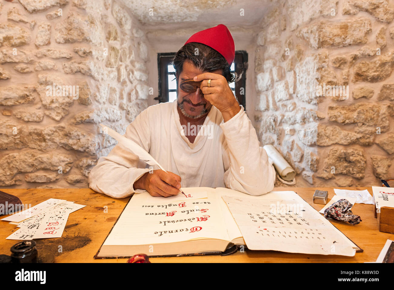 Man dressed and acting as a scribe during the annual Medieval Days Festival held in the old town of San Marino in - Stock Image