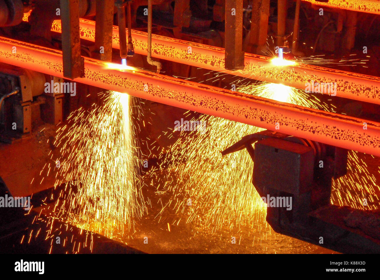 Steel billets in a continuous casting machine in a steel mill - Stock Image