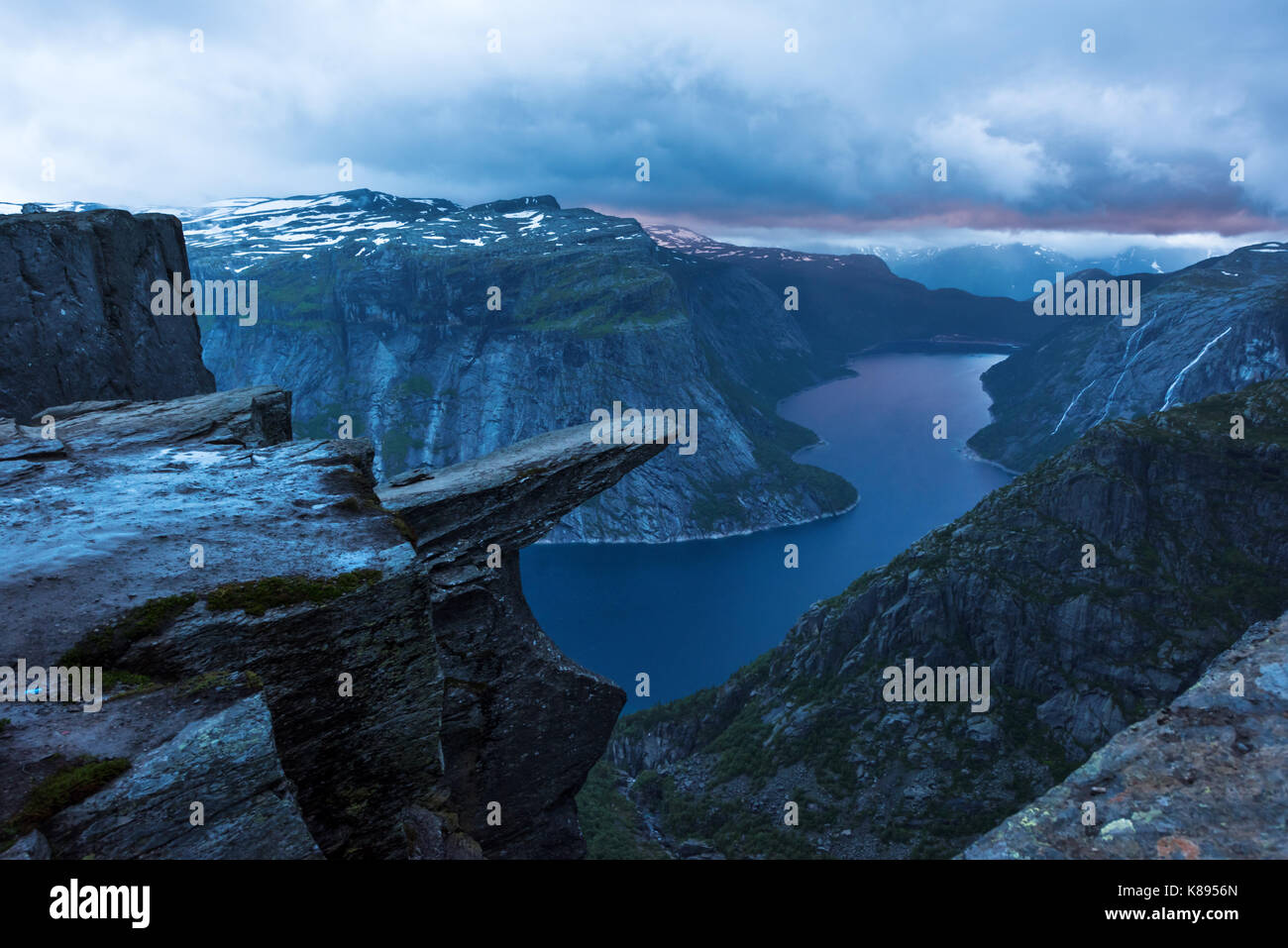 Breathtaking view of Trolltunga rock - most spectacular and famous scenic cliff in Norway - Stock Image