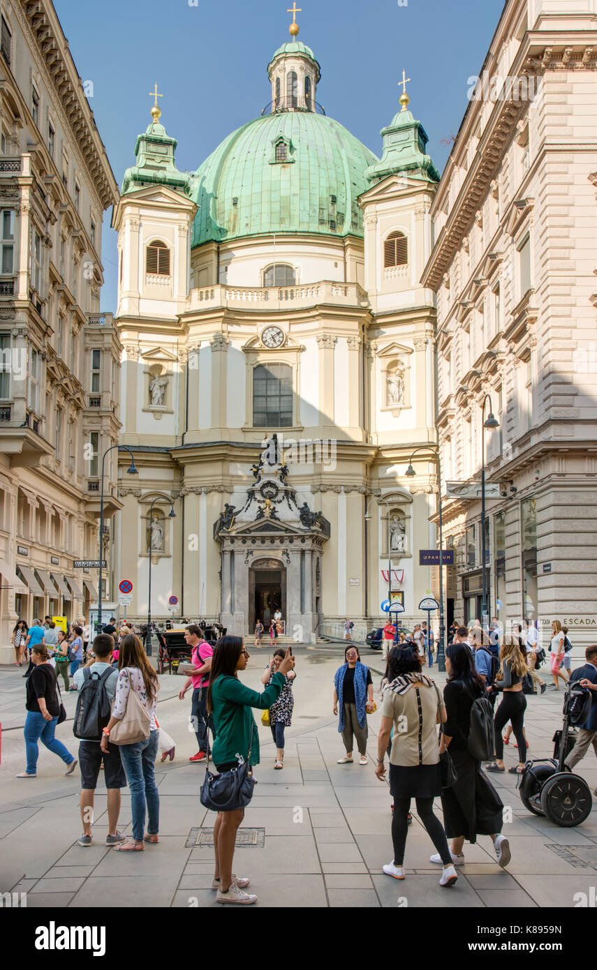VIENNA, AUSTRIA - AUGUST 28: Tourists at the baroque Peterskirche church in Vienna, Austria on August 28, 2017. - Stock Image