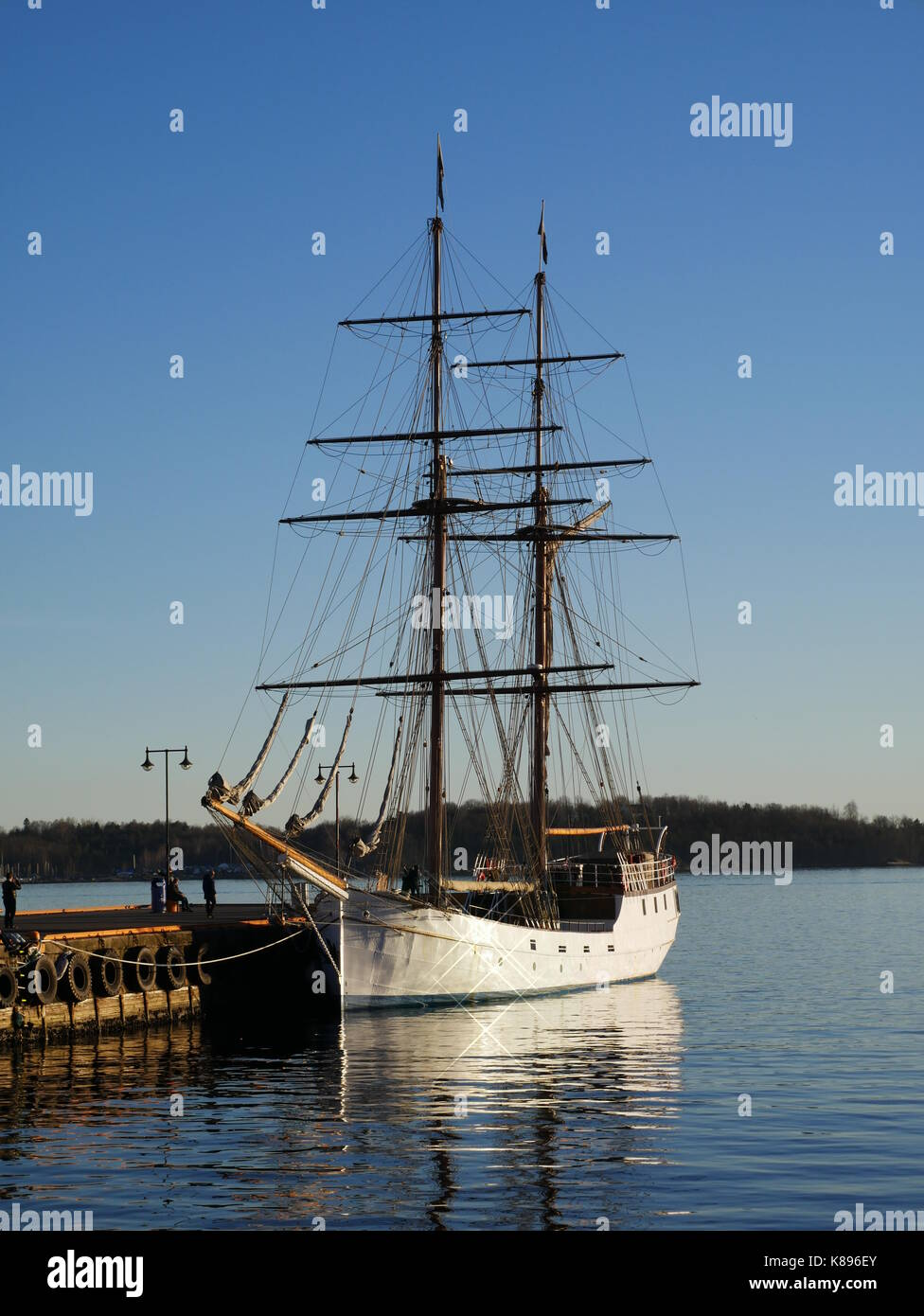 Tall ship S/V Legend at the jetty on a pleasant evening in Oslo, Norway Stock Photo