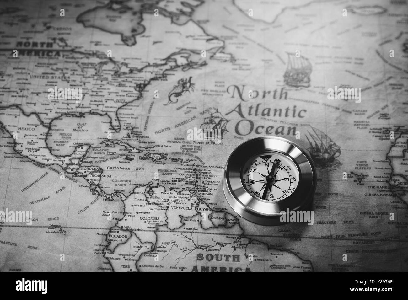 Old vintage retro golden compass on ancient map  Selective