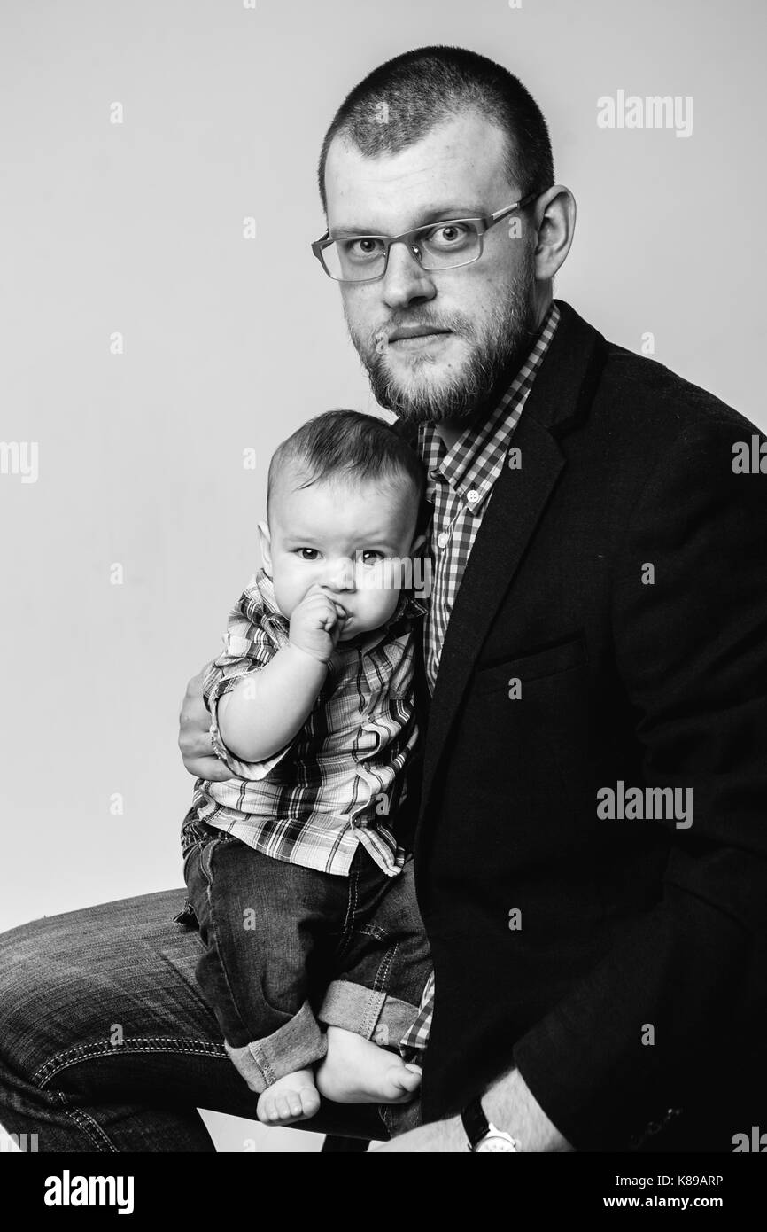 studio portait of father and baby son - Stock Image