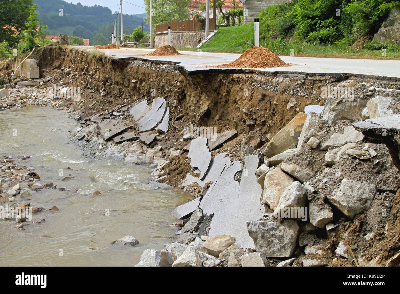 Part of Road Landslide Erosion After Floods - Stock Image