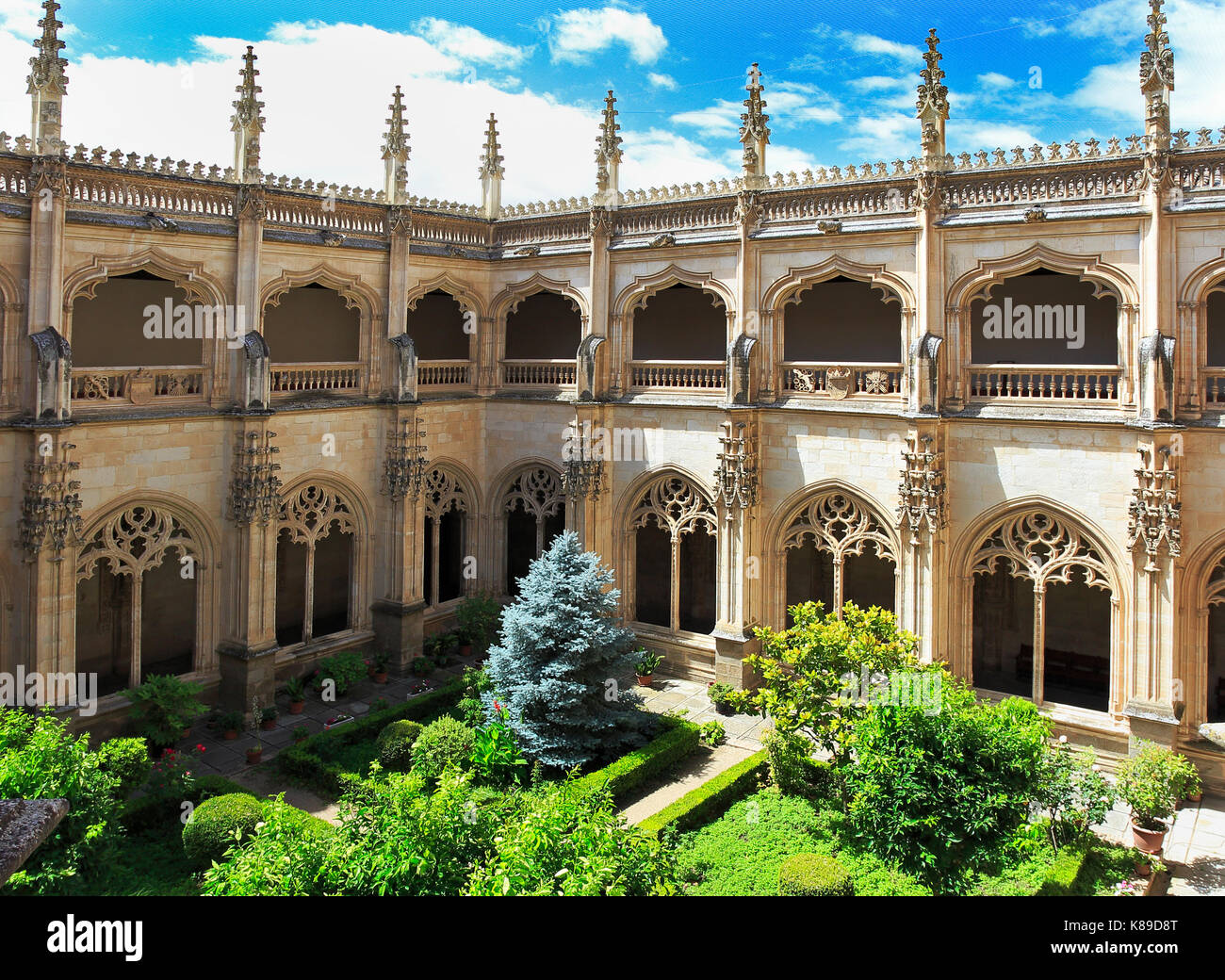 TOLEDO, SPAIN - JUNE 26, 2017: The Monastery of San Juan de los Reyes is an Isabelline style monastery in Toledo, - Stock Image