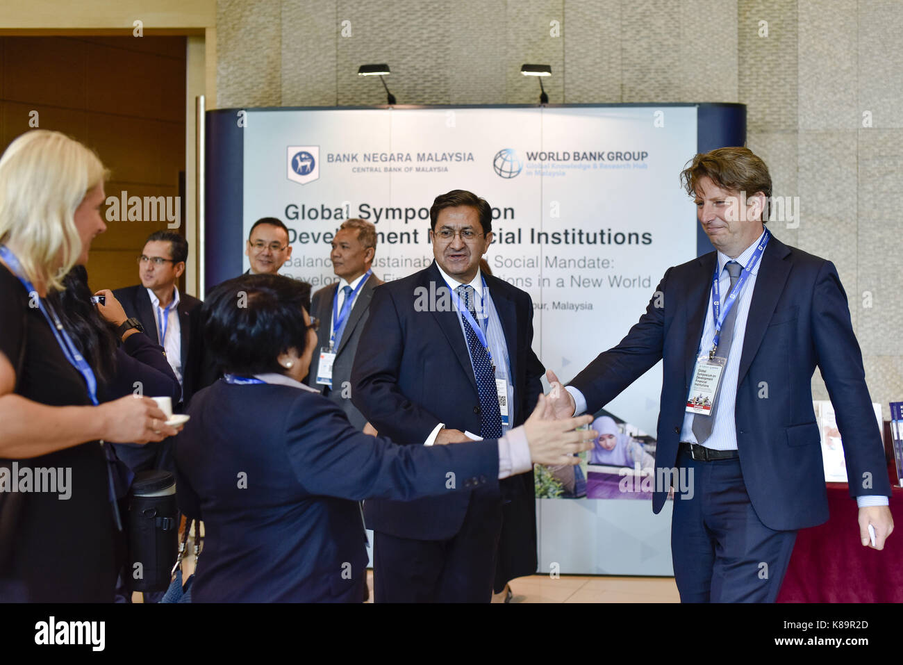 Kuala Lumpur, Malaysia. 19th Sep, 2017. Global Symposium on Development Financial Institutions participants are - Stock Image