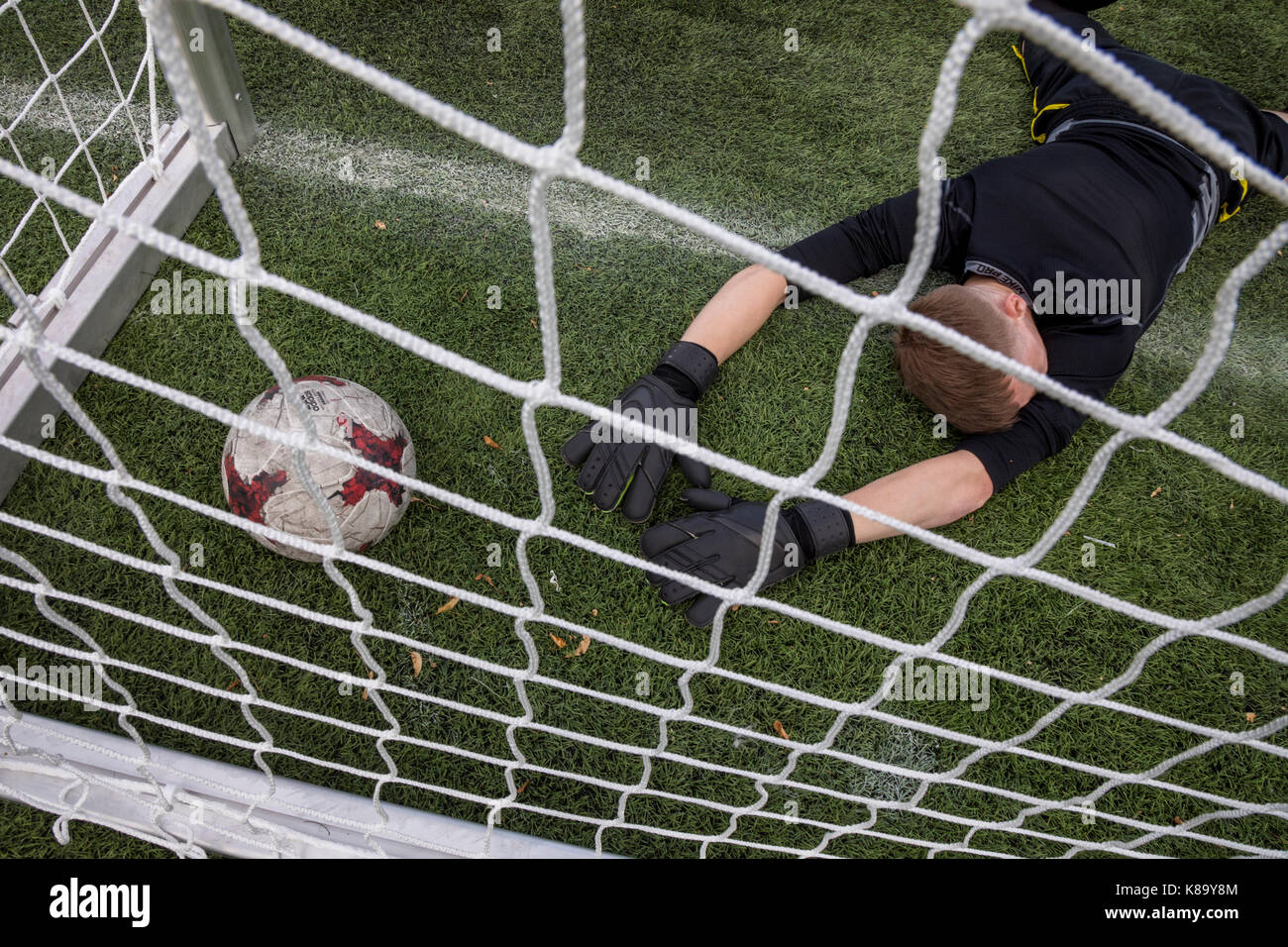 A goalkeeper of the amateur football team missed the ball 'KRASAVA' of 2018 FIFA World Cup on the football - Stock Image