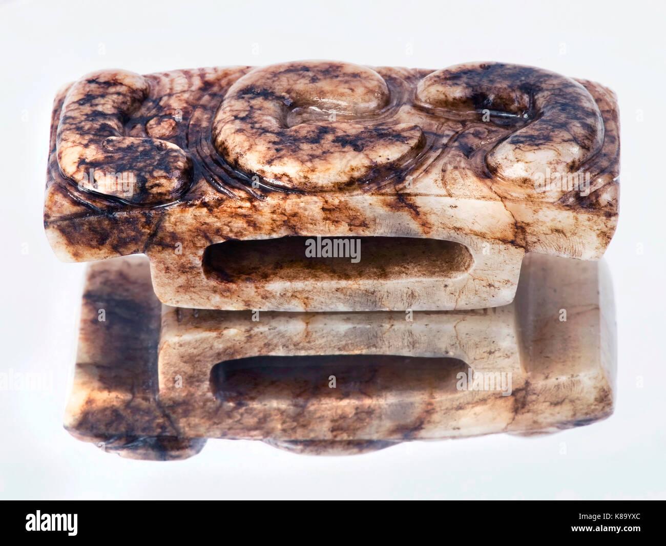 Antique 19th century Chinese Jade dagger hilt. Stock Photo