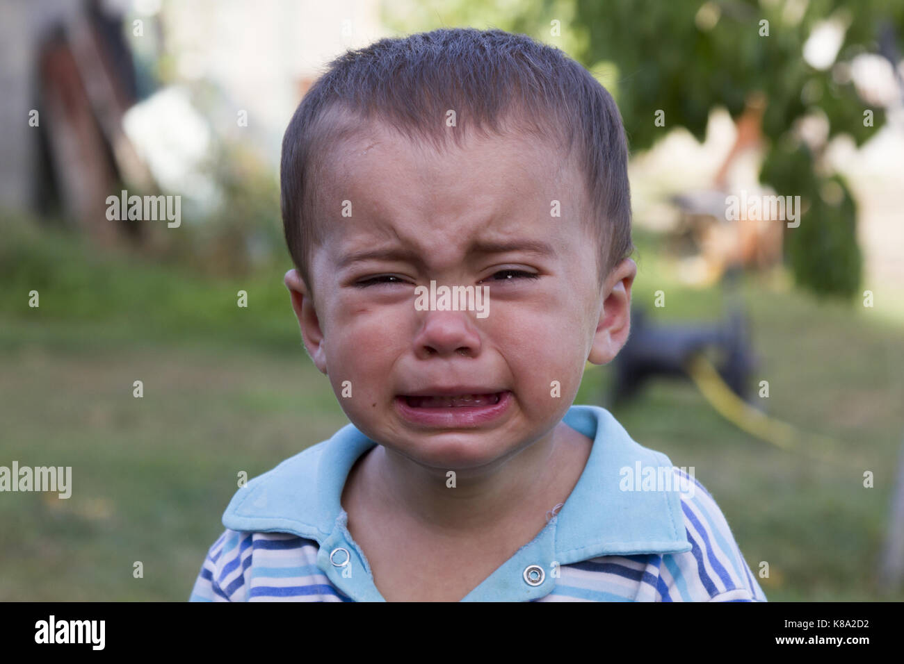 The little boy is crying loudly - Stock Image