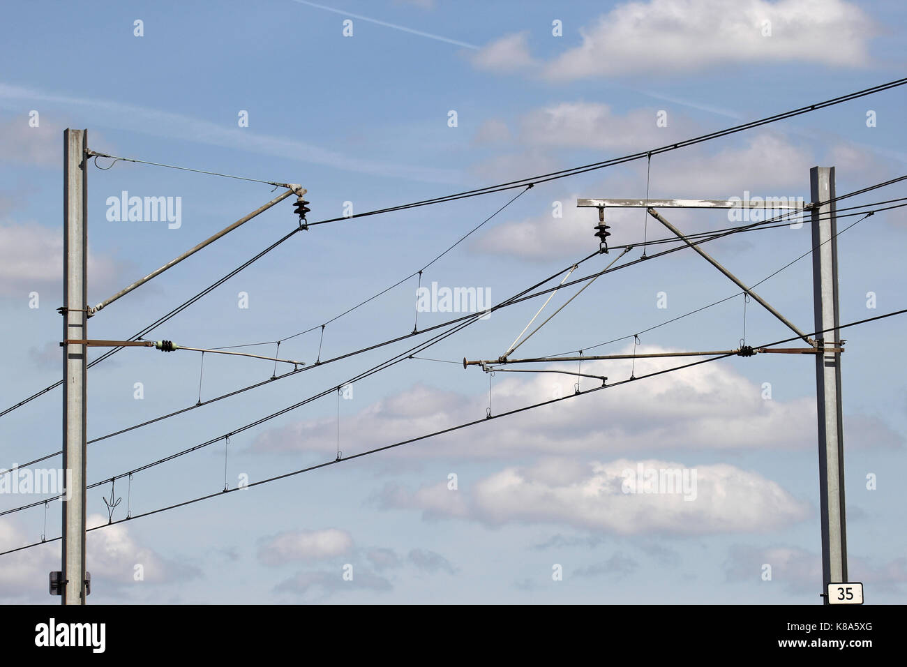 catenary at railway embankment Stock Photo