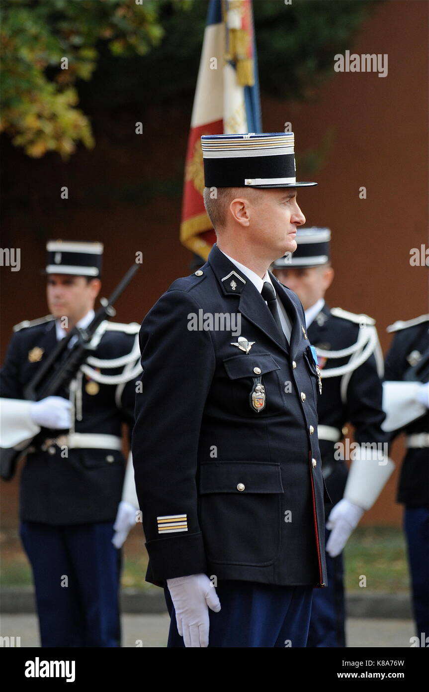 Parade under arms at Delfosse Gendarmery Barracks to pay homage to Lieutenant-Colonel Hervé Petry, Lyon, France - Stock Image