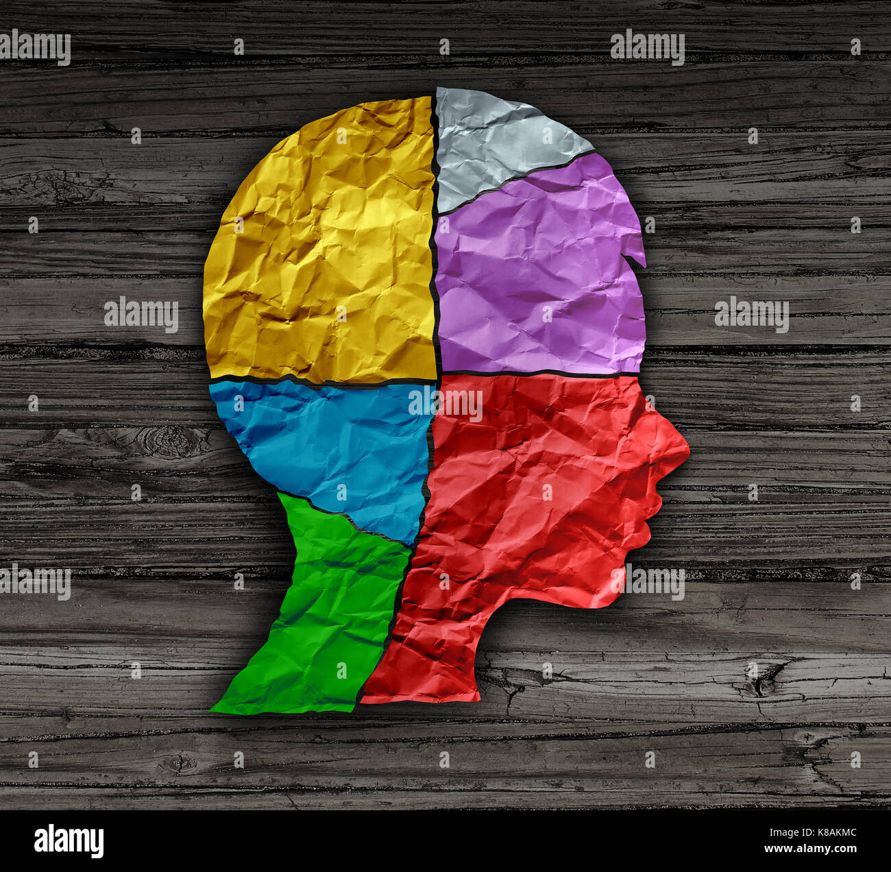 Child mood psychology change as a young person head shape made from crumpled paper as a mental health metaphor for - Stock Image