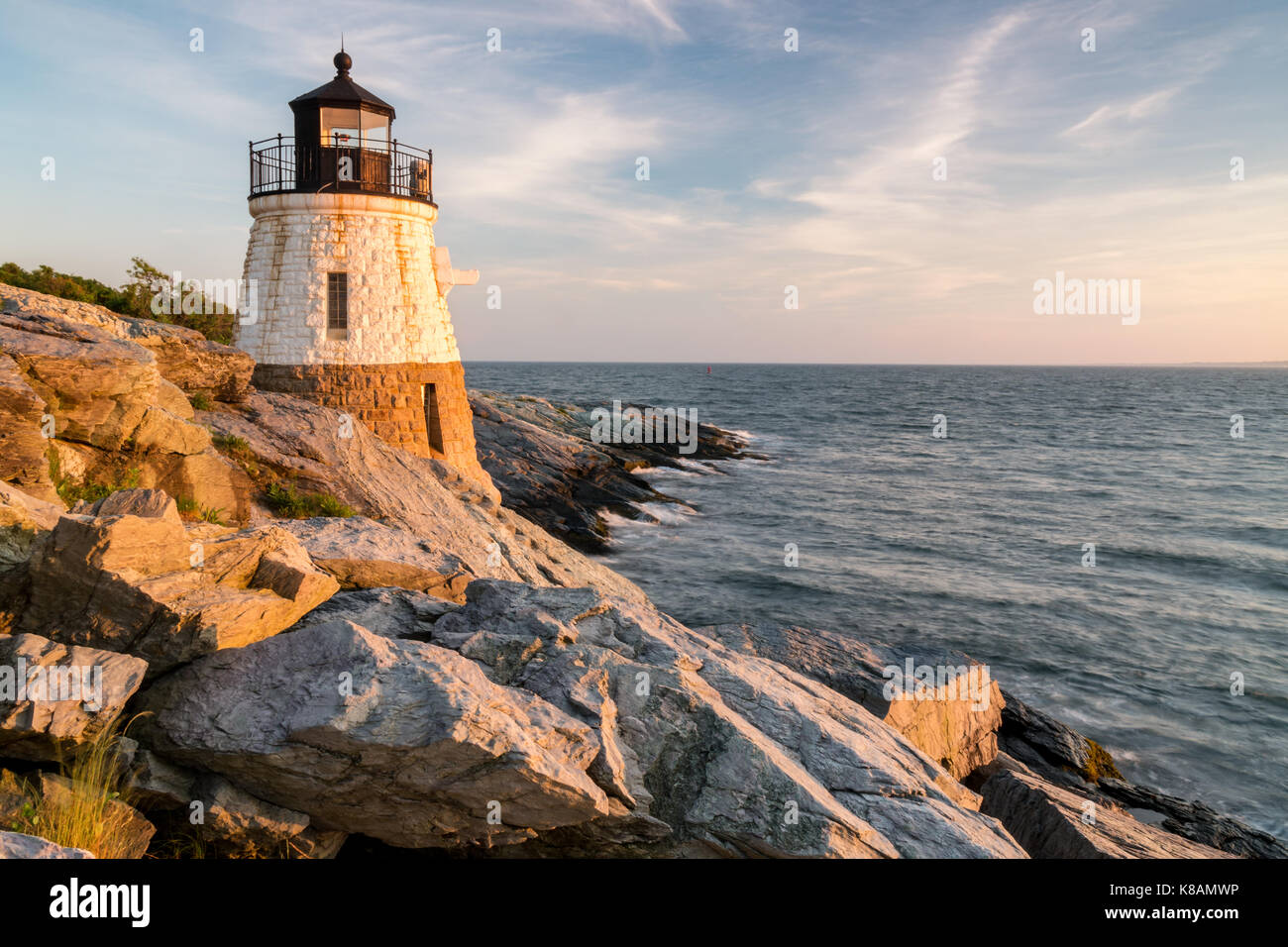 Castle Hill Lighthouse bathed with the warm glow of sunset, Newport, Rhode Island - Stock Image