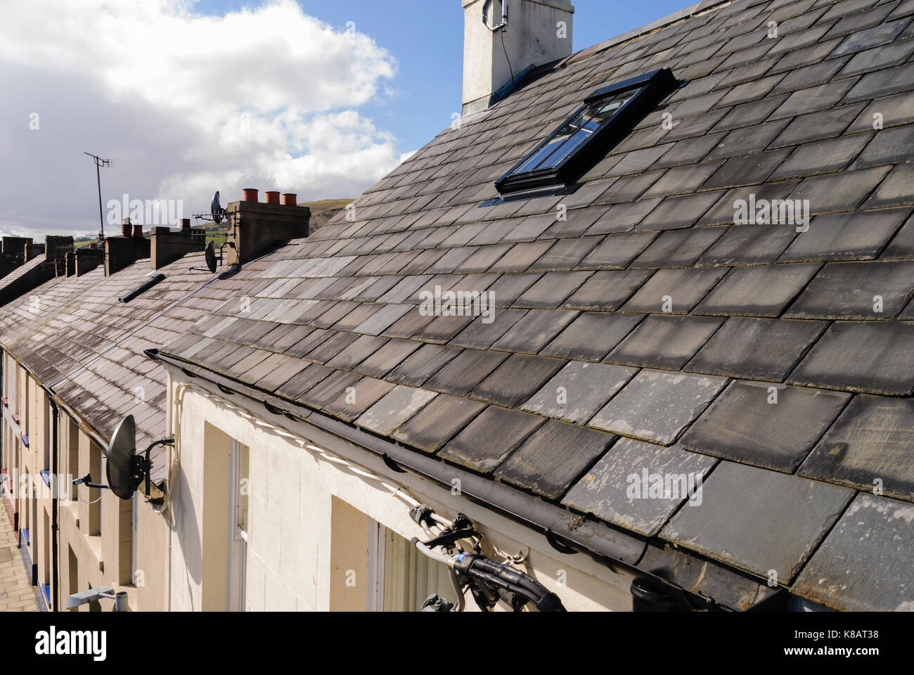 Roof tiles on a terrace row of old houses. - Stock Image