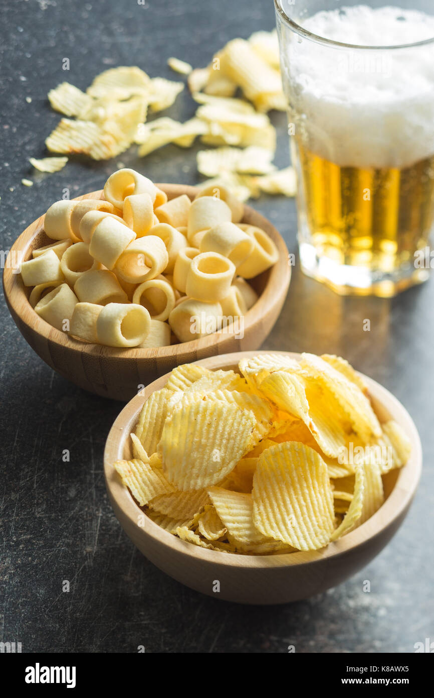 Crispy potato chips and rings in bowl. Salted potato chips. Stock Photo