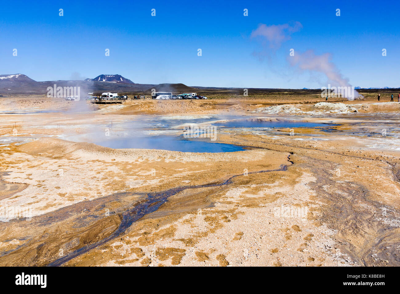 Steaming mud cauldrons and fumaroles at Námafjall Hverir geothermal area, Iceland - Stock Image
