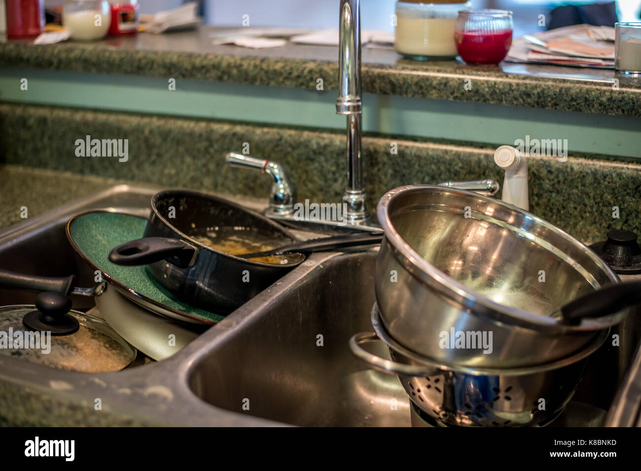 dirty dishes in the sink - Stock Image