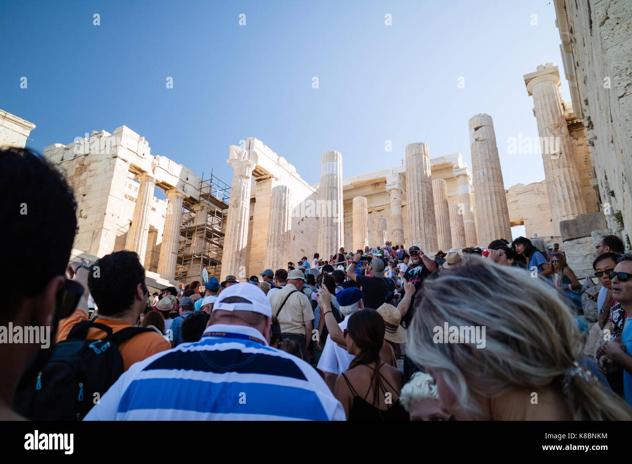 Crowd of Tourists queueing up to enter The Propylaea of the Athen Acropolis in Athens, Greece, Europe, Sep 2017 Stock Photo
