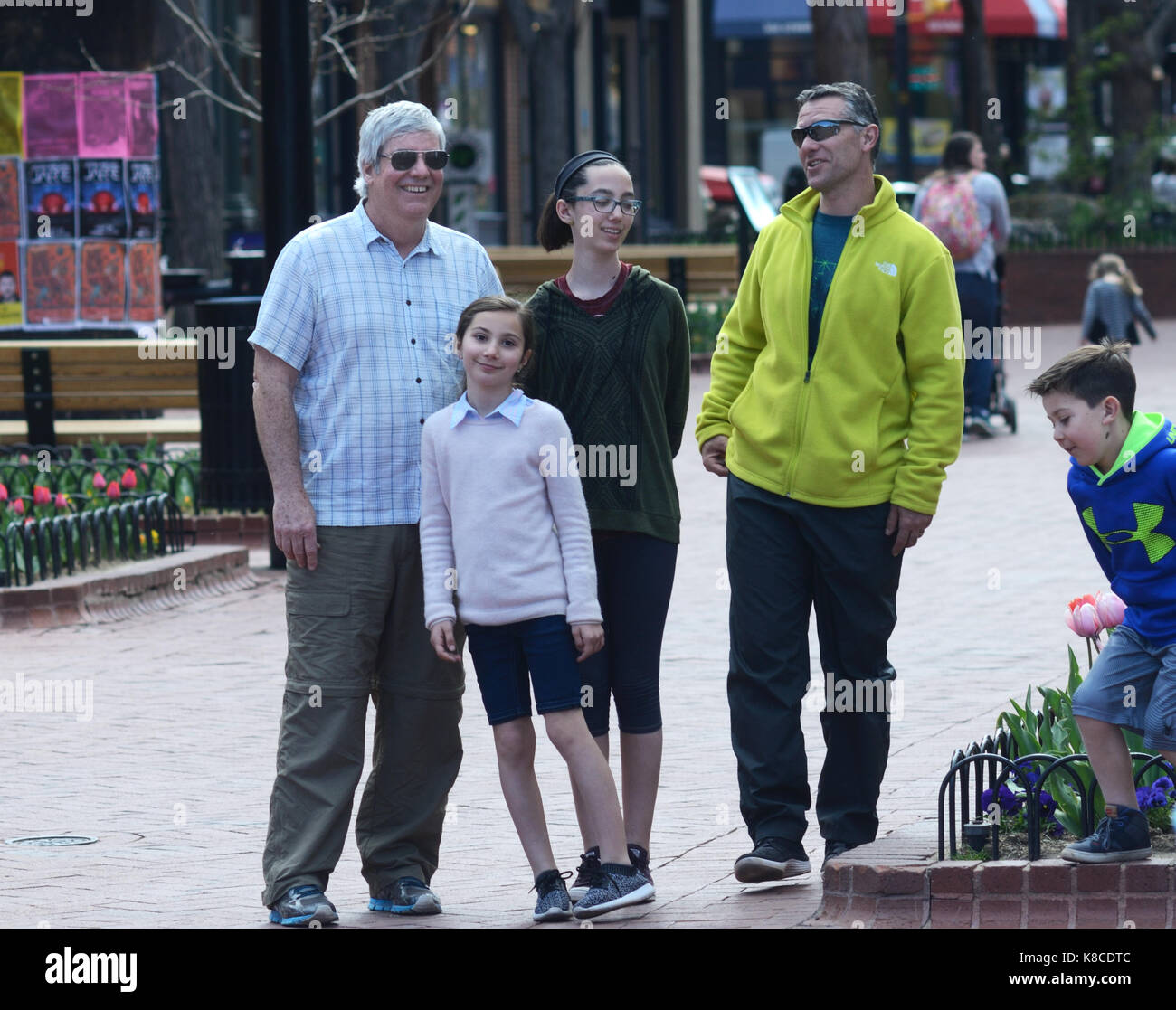 Group of people on Pearl Street Mall as they relax after posing for a photograph. - Stock Image