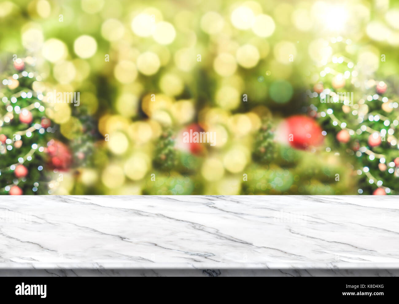 White Marble Table Top With Abstract Blur Christmas Tree Background With  Bokeh Light,Holiday Backdrop