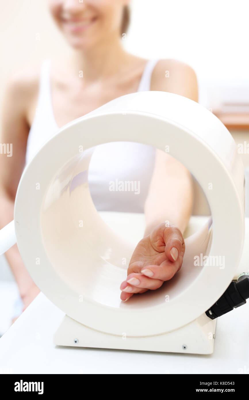 Magnetic field illumination. Magnetic field, hand rehabilitation in osteoarthritis - Stock Image