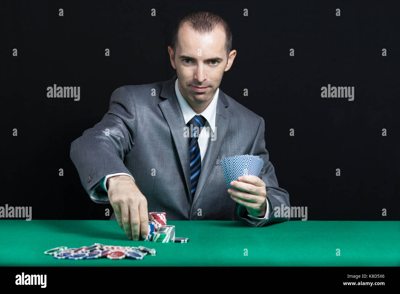 Blackjack Or Poker Game, Casino Worker Shuffling Cards - Stock Image