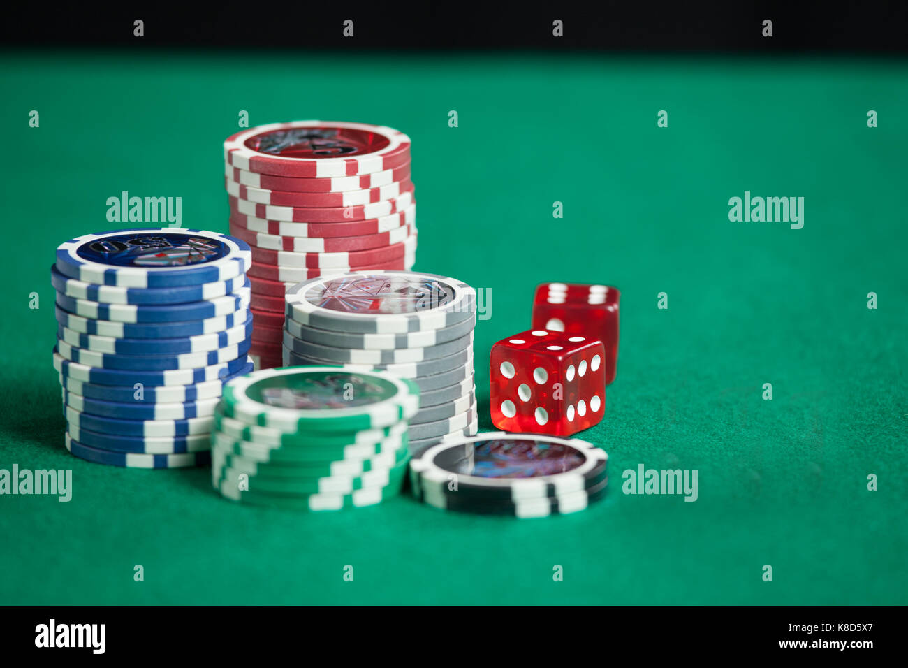 Blackjack at  casino ,Casino Chips And Red Dice - Stock Image