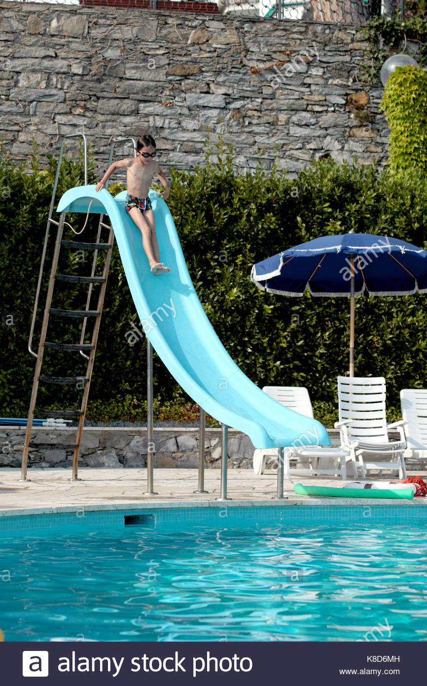 Perfect Child Sliding Down A Waterslide   Stock Image